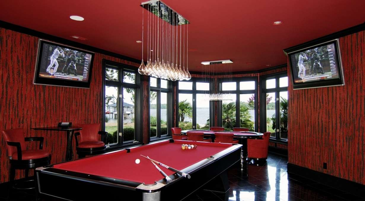 multiscreen media room with billiards